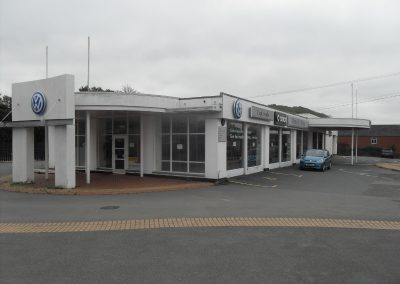 Former motor dealership with workshop facilities.